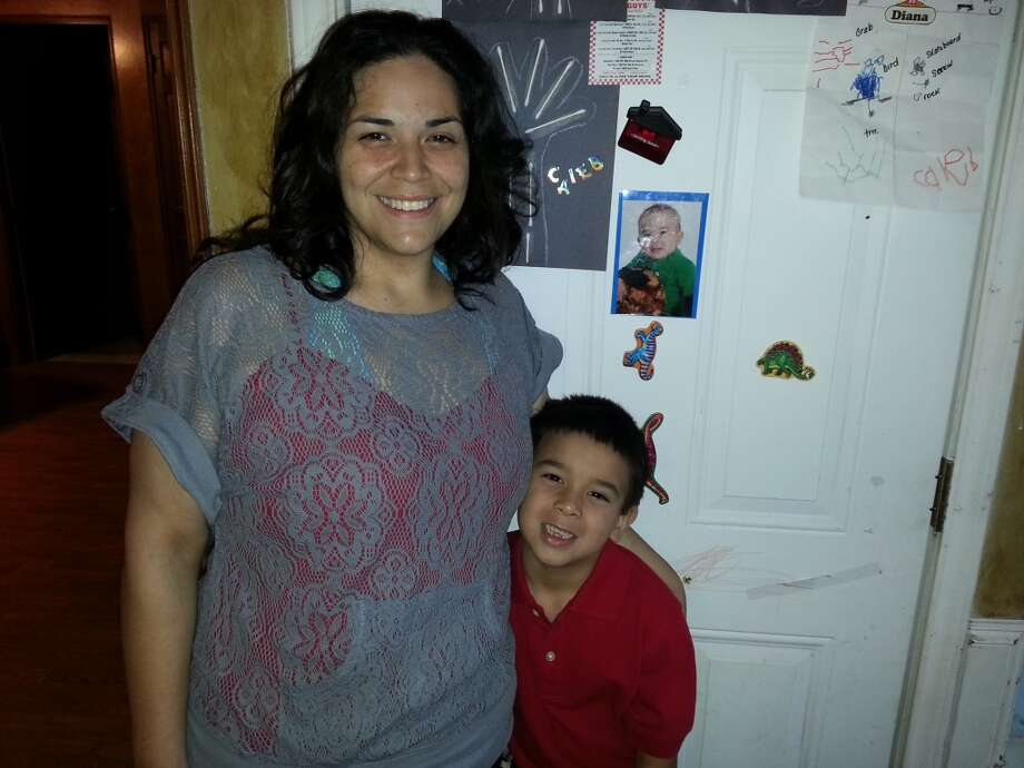 Caleb Otto with his mom, Diana Otto, before starting his first day of kindergarten in the Willowbrook area.