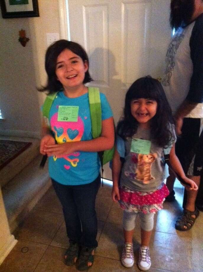 Melissa and Christina Mascorro are thrilled to go to school.