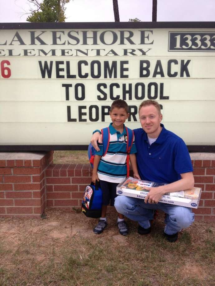 Clayton Smith and his son on the first day of first grade.