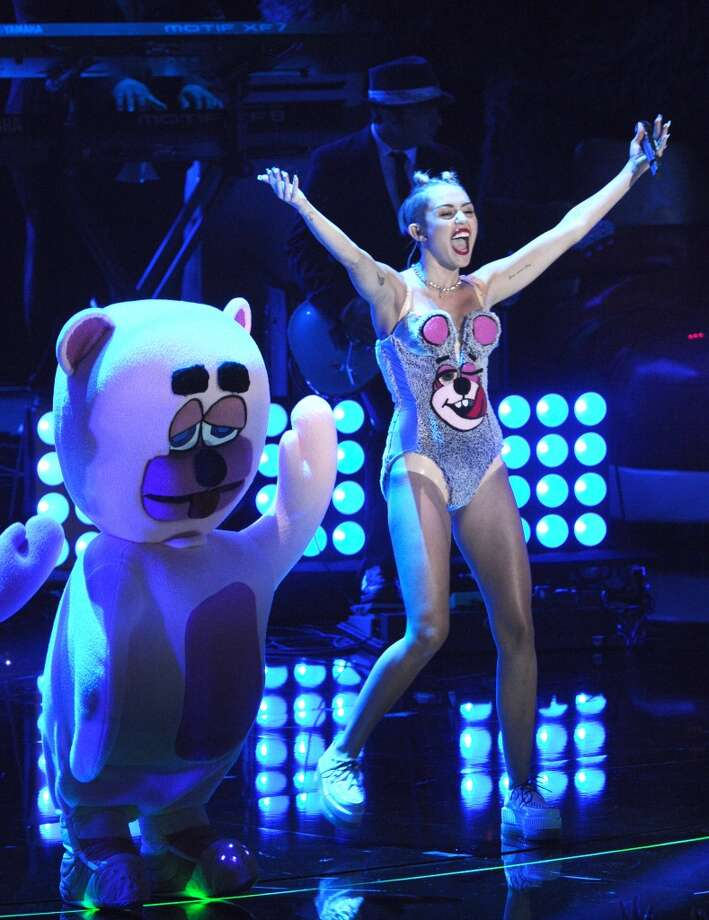 Miley Cyrus takes the stage with her giant teddy bears. Photo: Charles Sykes, Associated Press