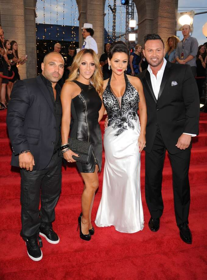 "Joe Gorga, left, and Melissa Gorga, of ""Real Housewives of New Jersey,"" and Jenni Farley, second right and Roger Mathews pose at the MTV Video Music Awards on Sunday, Aug. 25, 2013, at the Barclays Center in the Brooklyn borough of New York. (Photo by Scott Gries/Invision/AP) Photo: Scott Gries, Associated Press"