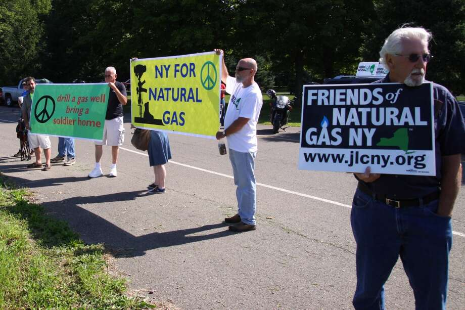 Signs of all sizes and styles at the Joint Landowners Coalition Rally as pro-drilling landowners gathered  Friday Aug. 23, 2013 near Otsiningo Park in Dickinson, N.Y. as the presidential motorcade makes its way southbound on Interstate 81. (AP Photo/Press & Sun-Bulletin, Jeff Miller) Photo: Associated Press