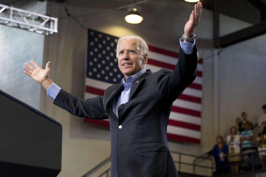 Vice President Joe Biden arrives to introduce President Barack Obama, to speak about college financial aid, at Lackawanna College in Scranton, Pa., Friday, Aug. 23, 2013, at the last stop on his two-day bus tour of upstate New York and Pennsylvania. (AP Photo/Jacquelyn Martin) Photo: Associated Press