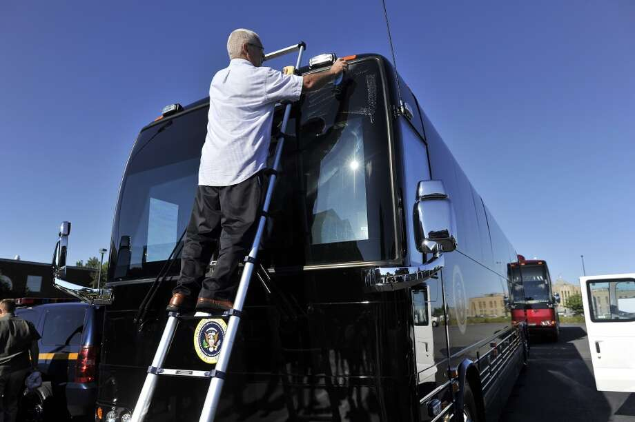 A staff cleans the presidential bus before US President Barack Obama takes to the road in Auburn, New York, on August 23, 2013. Obama is on a two-day bus tour through New York and Pennsylvania to discuss his plan to make college more affordable, tackle rising costs, and improve value for students and their families. AFP Photo/Jewel SamadJEWEL SAMAD/AFP/Getty Images Photo: AFP/Getty Images