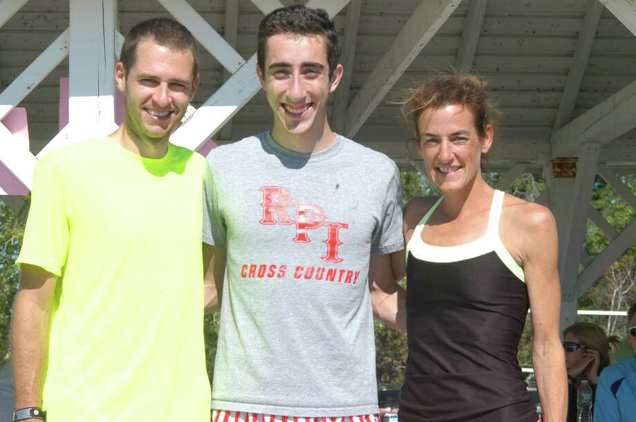 Patrick Cavanaugh, middle, winner of the Westport Road Runners Race, a 9.3 mile run on Saturday, is flanked by runner-up Geoff Williams, left, and top female finisher Mary Zengo, who was seventh overall. She broke the female course record in the process. Photo: Contributed Photo