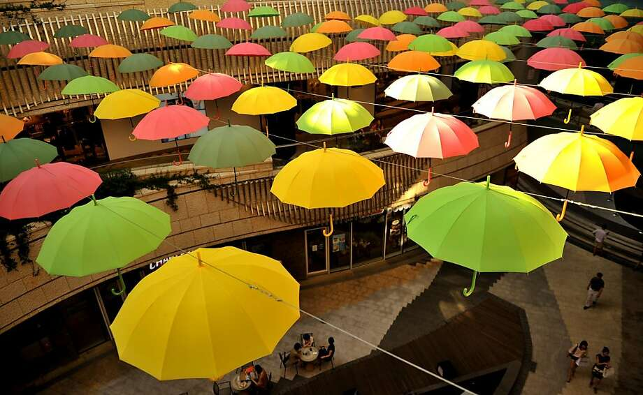 Retail overhead:Interior decorators in Seoul hang umbrellas on clotheslines and voila! Cutting-edge mall design. Photo: Truth Leem, AFP/Getty Images