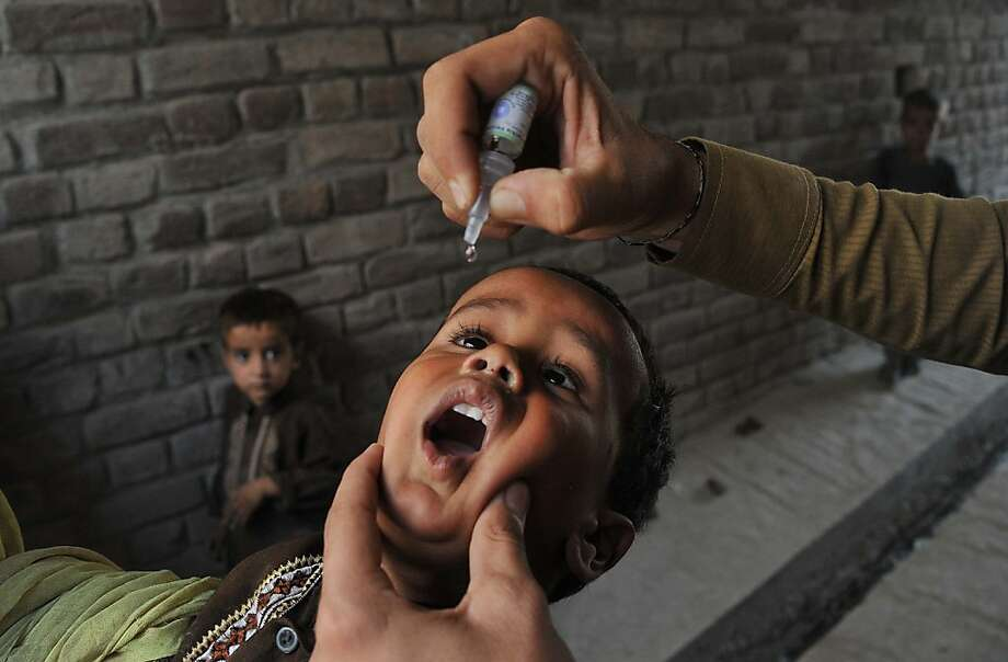 Bombs away!An Afghan health worker administers polio vaccine drops to a child during  a   vaccination campaign in Jalalabad. Photo: Noorullah Shirzada, AFP/Getty Images