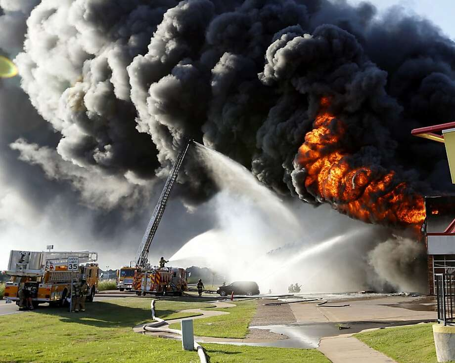 Burning rubber: Firefighters battle a blaze at Hibdon Tires in Norman, Okla., that spewed a spectacular column of smoke and flames. No injuries were reported. Photo: Steve Sisney, Associated Press