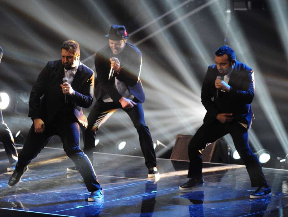 Joey Fatone, from left, Justin Timberlake and Chris Kirkpatrick of 'N Sync perform at the MTV Video Music Awards on Sunday, Aug. 25, 2013, at the Barclays Center in the Brooklyn borough of New York. (Photo by Charles Sykes/Invision/AP) Photo: Charles Sykes, Associated Press
