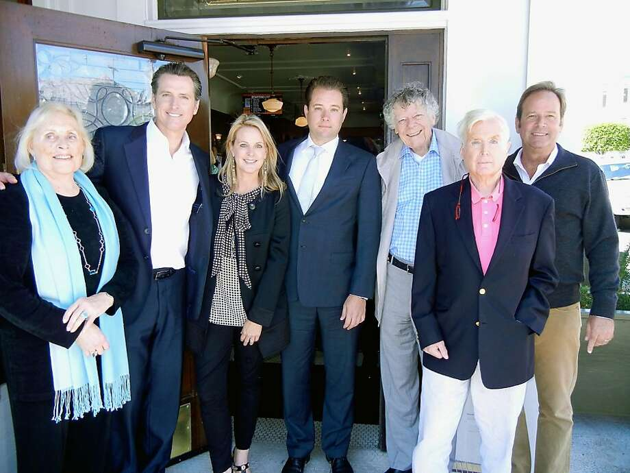 Pat Kelley (left), PlumpJack Group founder Lt. Gov. Gavin Newsom, his sister Hilary Newsom Callan, cousin Jeremy Scherer, Gordon Getty, Bill Newsom and PlumpJack winemaker John Conover. Photo: Catherine Bigelow, Special To The Chronicle