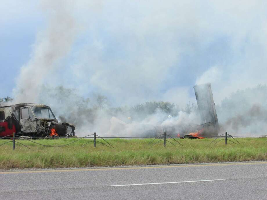 Smoke from burning plastic filled the air around 1 p.m. in Frio County on Interstate 35 near mile marker 110, between Moore and Pearsall, where a tractor-trailer hauling plastic crashed into a minivan. Photo: Eva Ruth Moravec / Express-News