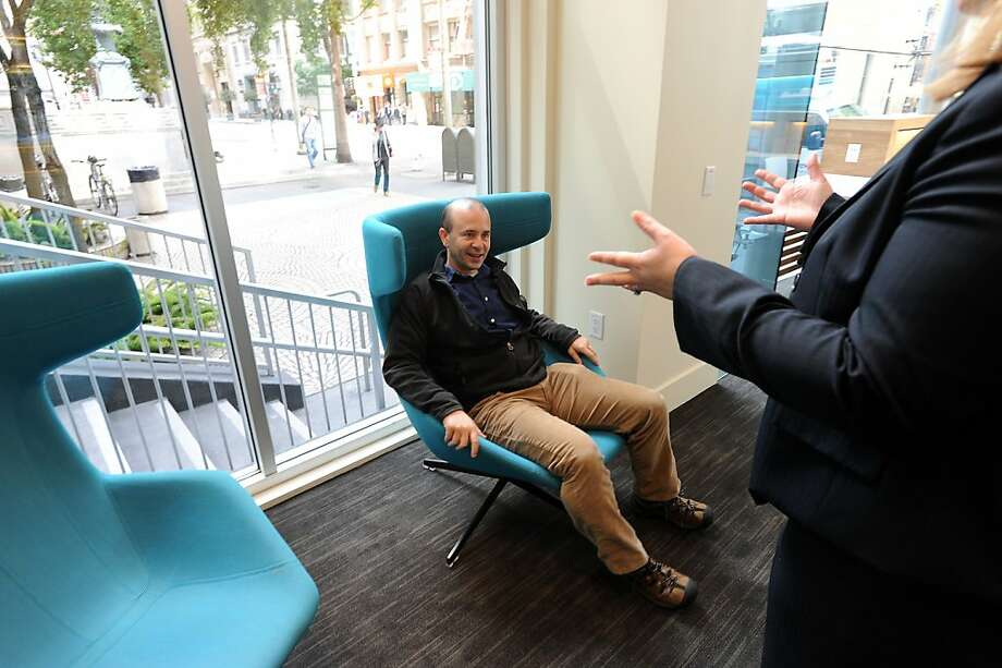 Guest Jon Ford tries a lounge chair in the resource center at Umpqua Bank's new flagship branch in San Francisco. Photo: Michael Short, Special To The Chronicle