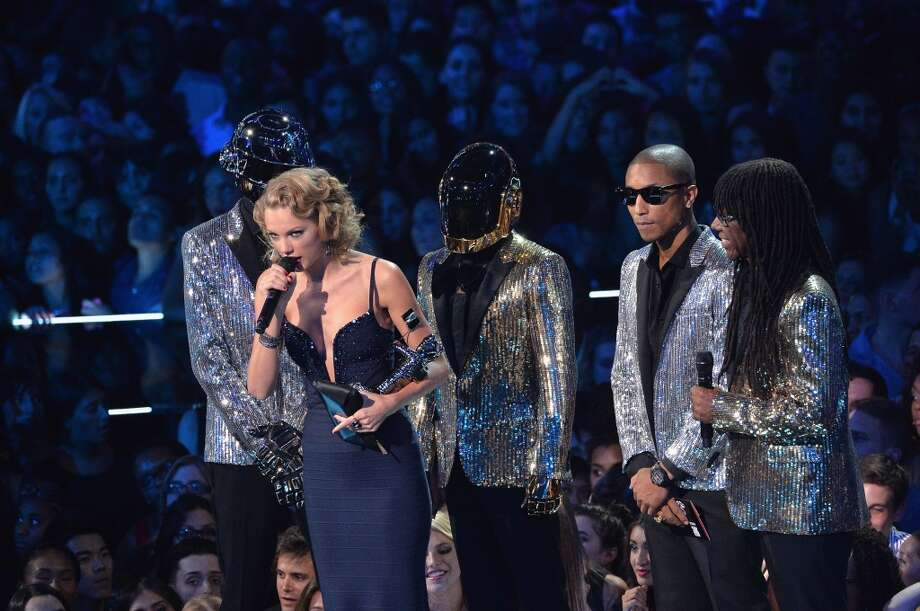 Taylor Swift accepts her  Moon Man, and thanks the person who inspired the song. Cutaway to Harry Styles. Photo: Rick Diamond, Getty Images For MTV