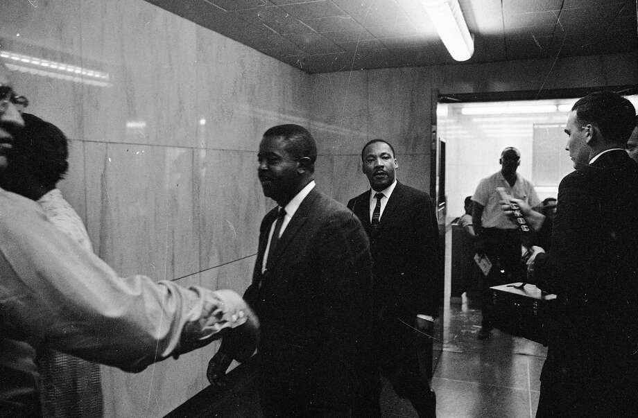 FILE - In this May 8, 1963 file photo, the Revs. Ralph Abernathy, left, and Martin Luther King, Jr. walk through a corridor of the city jail in Birmingham, Ala., where they were held for several hours following conviction on charges of parading without a permit. They posted bond of $2,500. Photo: AP