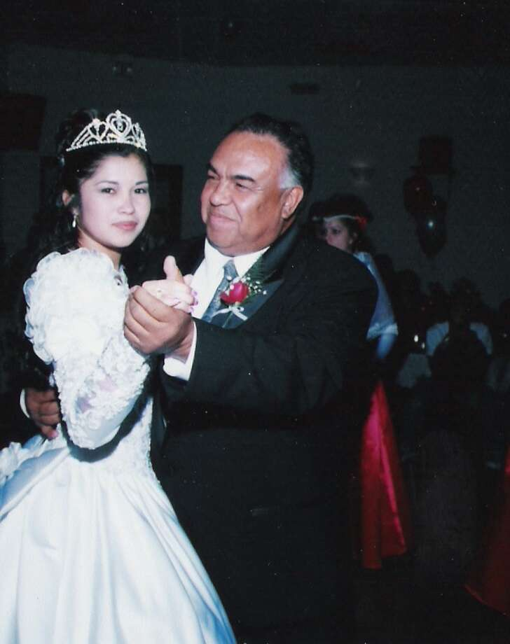 1998: Enrique Flores dances with granddaughter Andrea during her quinceanera  in San Jose, Calif. Photo: Courtesy