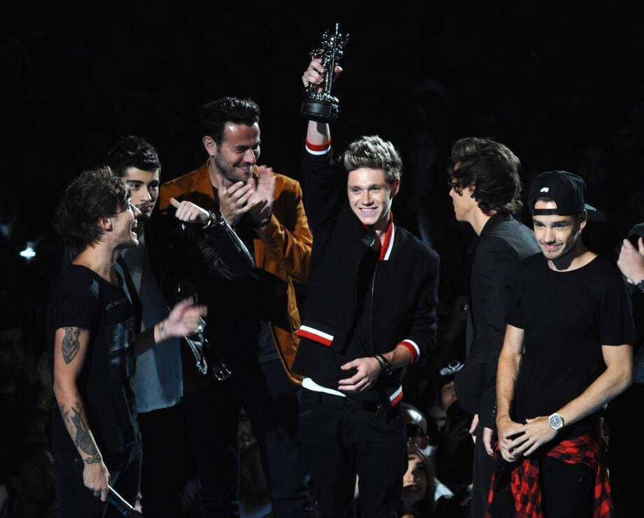 One Direction accepts  the Song of the Summer award to a chorus of boos from the audience. Photo: Charles Sykes, Associated Press