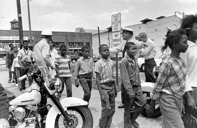 FILE - In this May 4, 1963 file photo, police lead a group of black school children to jail after their arrest for protesting against racial discrimination near city hall in Birmingham, Ala. Photo: Bill Hudson
