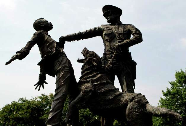 """A young protester confronted by a police officer and a snarling police dog is depicted in a sculpture in Kelly Ingram Park in Birmingham, Ala. on Tuesday, Aug. 6, 2013. As the nation marks the 50th anniversary of the Rev. Martin Luther King Jr.'s """"I Have A Dream"""" speech, there may be no better place than Birmingham to measure the progress that followed the civil rights leader's historic call for racial and economic equality.  PART OF A PACKAGE OF 25 PHOTOS WITH THE STORY """"MEASURING MLK'S DREAM"""" Photo: Butch Dill"""
