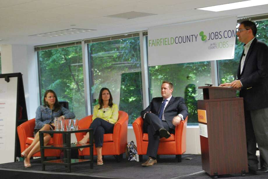 FairfieldCountyJobs.com CEO David Lewis moderates a panel discussion with, from left, Meghan Hurley of Reed Exhibitions, Janine Labadia of Design Within Reach, and Jeremiah Patterson of Noble Americas. The event was held for nearly 100 jobseekers last Thursday in the FairfieldCountyJobs.com offices in Norwalk. Photo: Contributed Photo