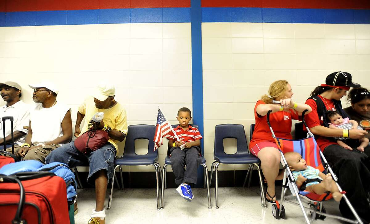 Four-year-old Damien Anderson waits to evacuate with others at West Brook High School in Beaumont two days before Hurricane Ike. Enterprise file photo