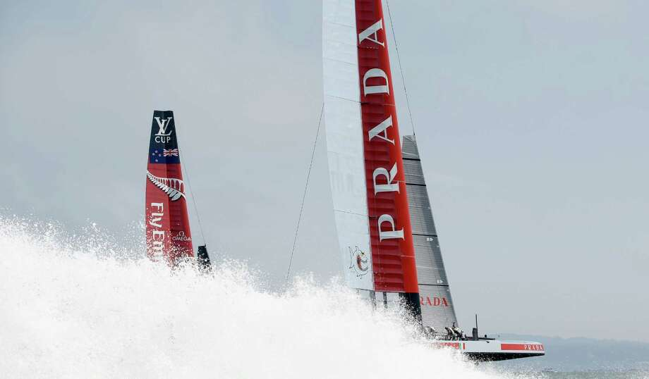 Team Luna Rossa Challenge, shown racing during the Louis Vuitton Cup challenger series against Team Emirates New Zealand, has filed a challenge over defending champion Team Oracle's setting of rules for the 2017 Cup. Photo: Ezra Shaw / Getty Images / 2013 Getty Images