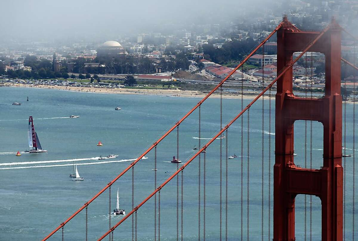 An America's Cup yacht (which, yeah, you're not going to be able to rent) sails by the Golden Gate Bridge.