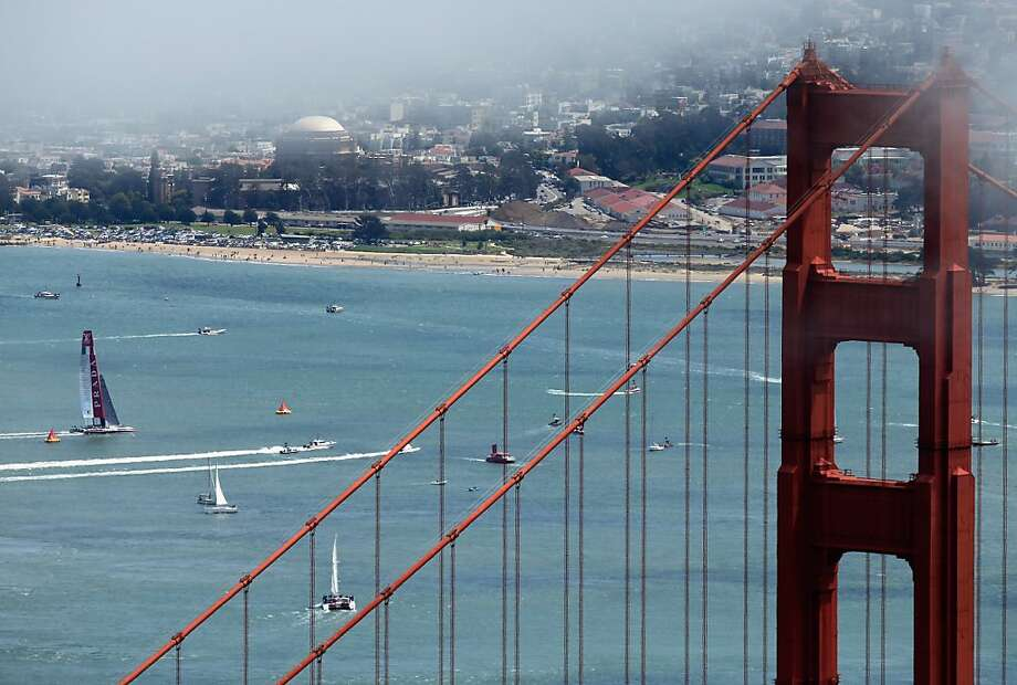 An America's Cup yacht (which, yeah, you're not going to be able to rent) sails by the Golden Gate Bridge. Photo: Ezra Shaw, Getty Images