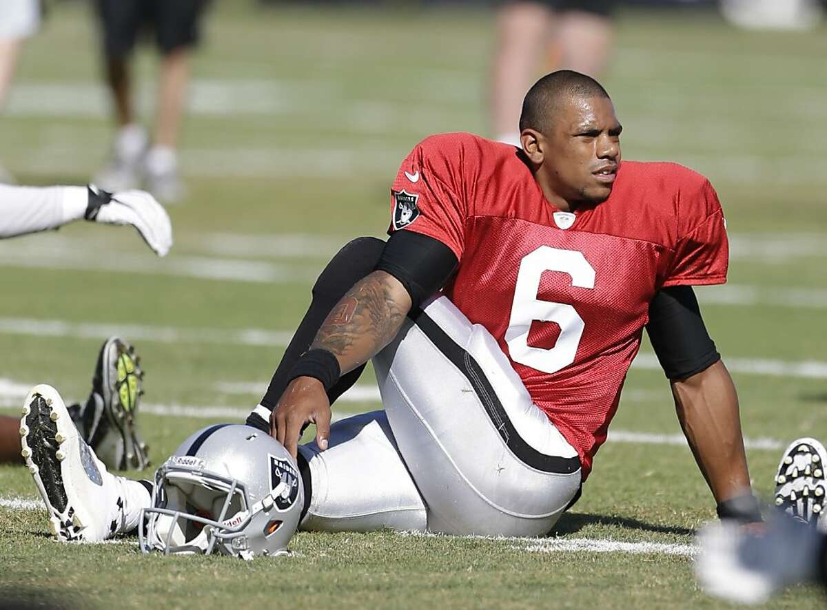 Oakland Raiders quarterback Terrelle Pryor during their NFL football training camp Friday, Aug. 2, 2013, in Napa, Calif. (AP Photo/Eric Risberg)