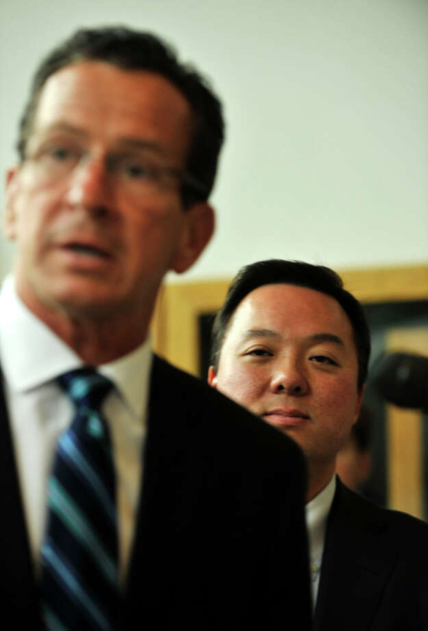 Gov. Dannel P. Malloy, left, endorses William Tong for mayor of Stamford during an announcement at the Stamford Government Center on Monday, Aug. 26, 2013. Photo: Jason Rearick / Stamford Advocate
