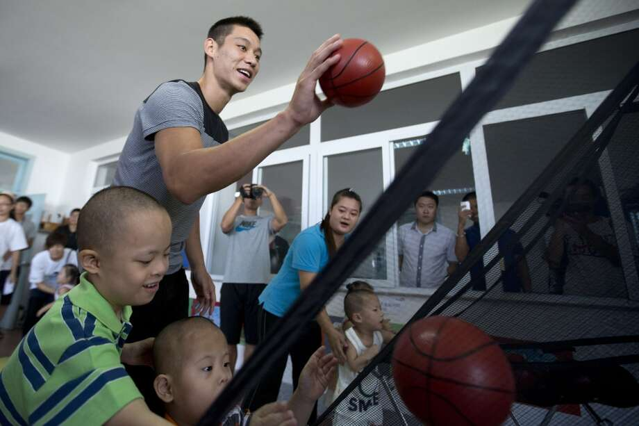 Jeremy Lin should be a basketball with children while he visits an orphanage and rehabilitation center that serves children with congenital illnesses such as cerebral palsy in Tianjin, China Photo: Alexander F. Yuan, Associated Press