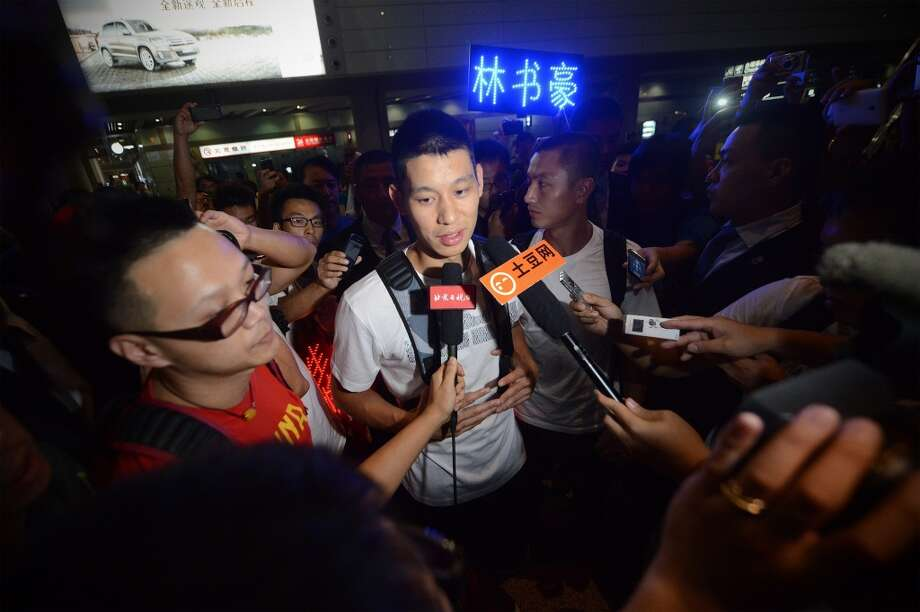 Jeremy Lin speaks to the media after arriving at an airport in Beijing. Photo: Wang Zhaowang Zhao, Getty Images