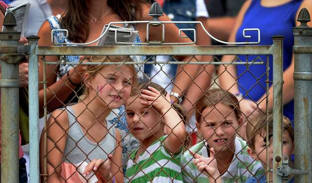 Young race patrons try to get a good vantage point to watch the 4th race Monday afternoon, Aug. 26, 2013, at Saratoga Race Course in Saratoga Springs, N.Y. Hayley Cerza, 7, left, Greta Cerza, 5, Matty Cerza, 9, all of Glenmont and Sullivan Brown, 4, of Natick, Mass., right, enjoy the day of race action at the historic venue.  (Skip Dickstein/Times Union) Photo: SKIP DICKSTEIN