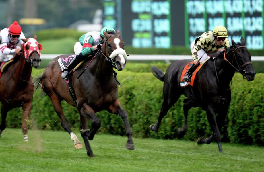Madame Giry with jockey Joseph Rocco Jr., left,  passes #7 Rosa Salvaje with jockey Alex Solis to win The Besilu Stables The Smart N Fancey overnight stakes Monday afternoon, Aug. 26, 2013, at Saratoga Race Course in Saratoga Springs, N.Y. (Skip Dickstein/Times Union) Photo: SKIP DICKSTEIN