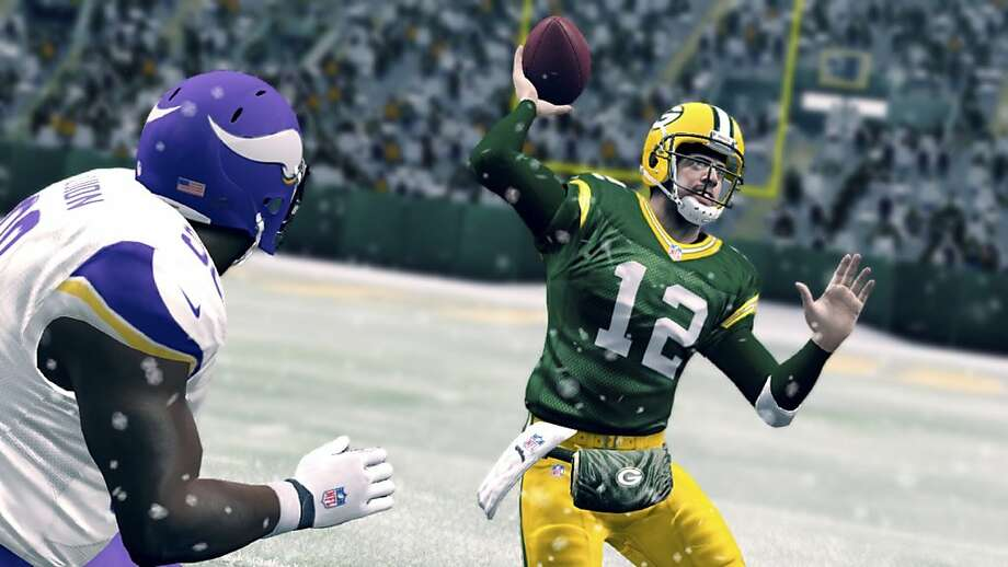 "In a scene from the video game ""Madden NFL 25,"" Packers quarterback Aaron Rodgers tries to evade the Vikings defense. Photo: Ea Sports, New York Times"
