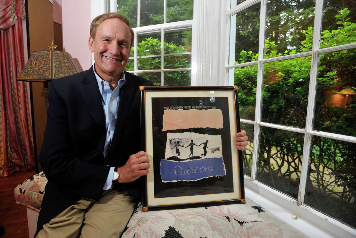 """Steve Simmons poses with a poster from Dr. Martin Luther King Jr's """"I have a dream"""" speech in his home in Greenwich, Conn., on Monday, Aug. 26, 2013. Simmons witnessed Dr. King's 1963 speech and returned to Washington DC for the 50th anniversary of the speech."""
