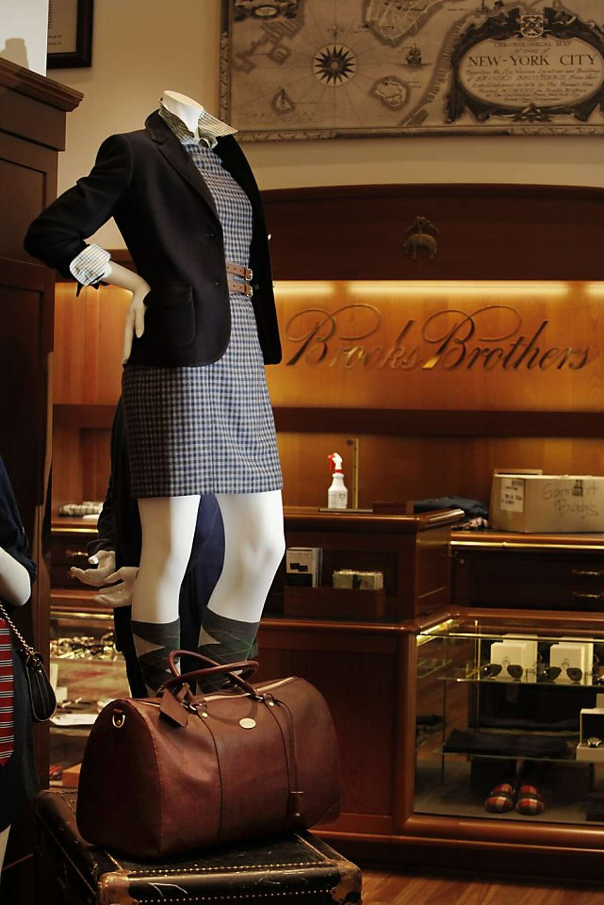 A mannequin is seen wearing Brooks Brothers clothing in the new Brooks Brother store on Thursday, August 22, 2013 in San Francisco, Calif.