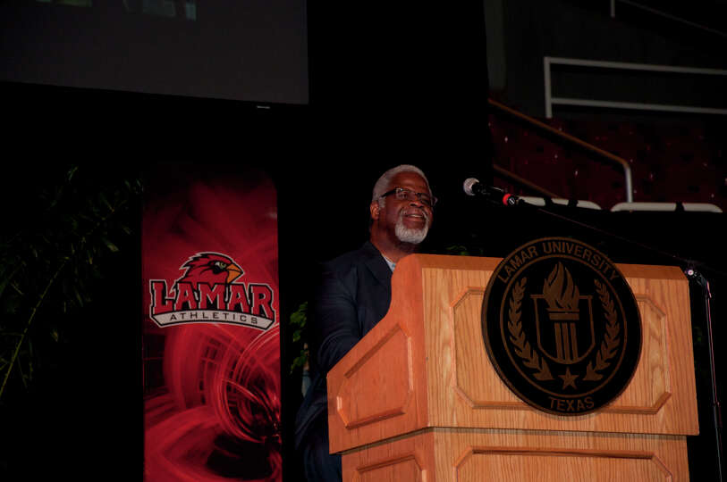 Earl Campbell on stage addressing the team at the Lamar Cardinal Football Kick Off Celebration in th