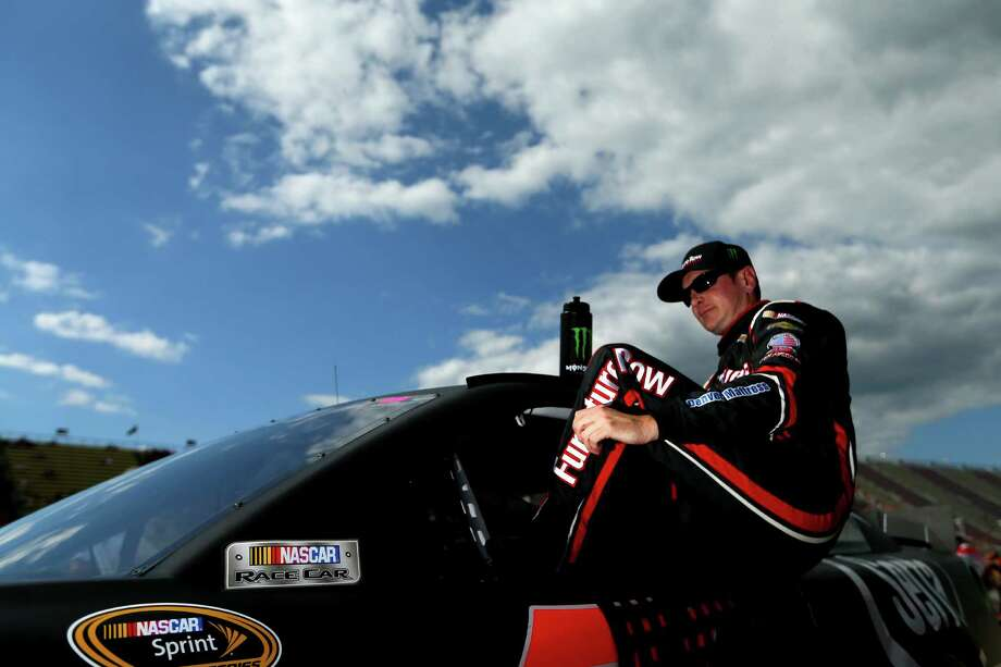 BROOKLYN, MI - AUGUST 16:  Kurt Busch, driver of the #78 Furniture Row / Serta Chevrolet, climbs out of his car after qualifying for the NASCAR Sprint Cup Series 44th Annual Pure Michigan 400 at Michigan International Speedway on August 16, 2013 in Brooklyn, Michigan.  (Photo by Mike Ehrmann/Getty Images) ORG XMIT: 176779579 Photo: Mike Ehrmann / 2013 Getty Images