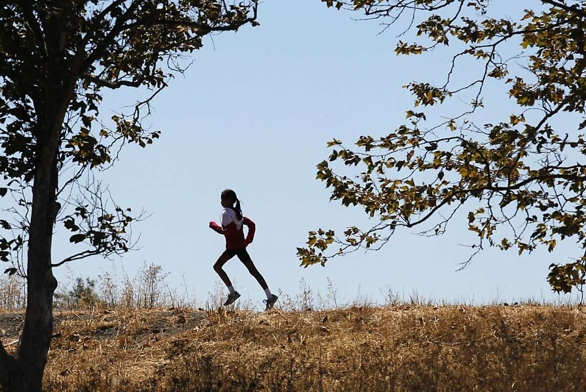 11-year-old Rithika Vatturi runs near her home in Union City, Calif. on Saturday August 24, 2013. By wearing the Ortho -K contact lenses at night Rithika is able to train during the day without the use of glasses. Doctors and researchers are developing new techniques to slow down or even prevent the progression of myopia (nearsightedness) once it starts in kids. Once such technique uses hard contact lens known as