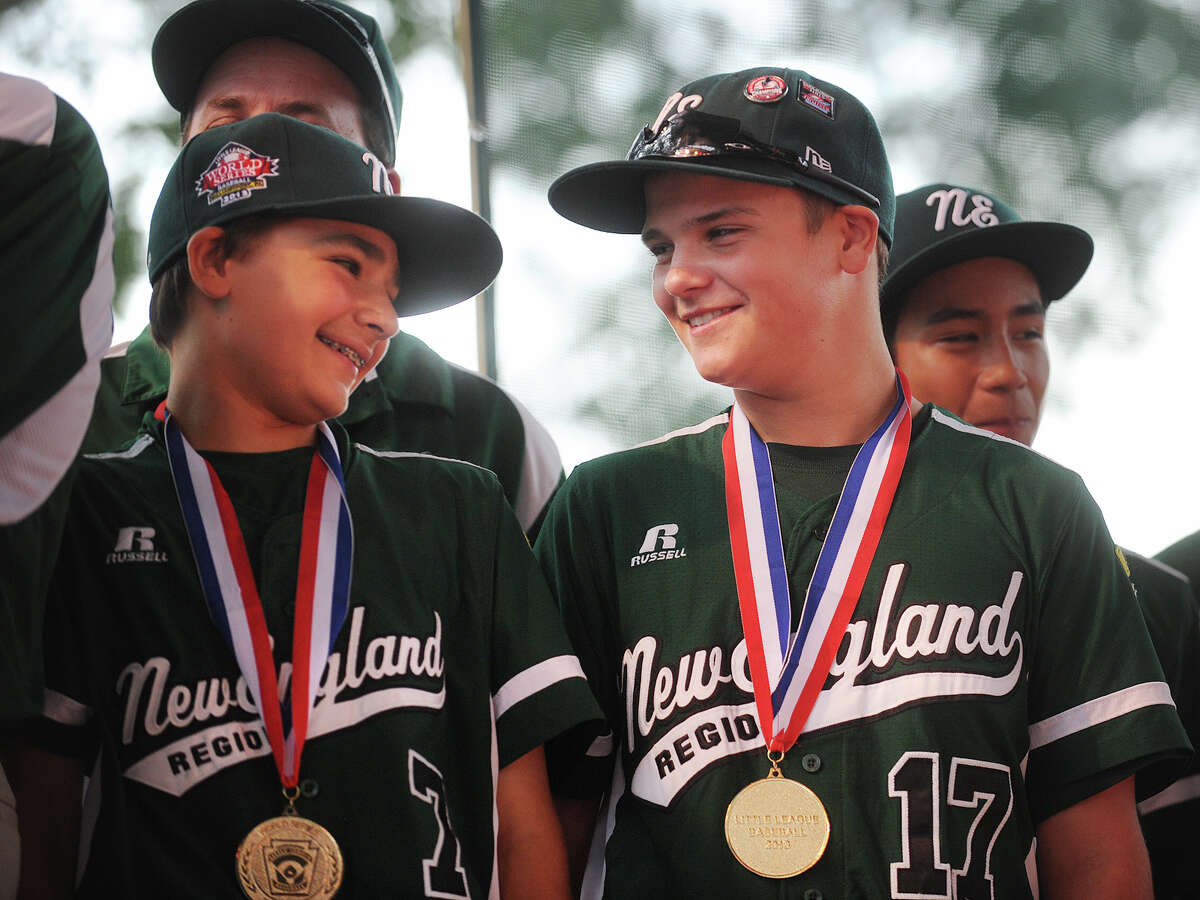 Teammates Christopher Drbal, left, and Charlie Roof share a smile as they attend a ceremony in honor of Westport Little League boys baseball and girls softball champions on Jesup Green in Westport, Conn. on Monday, August 26, 2013.