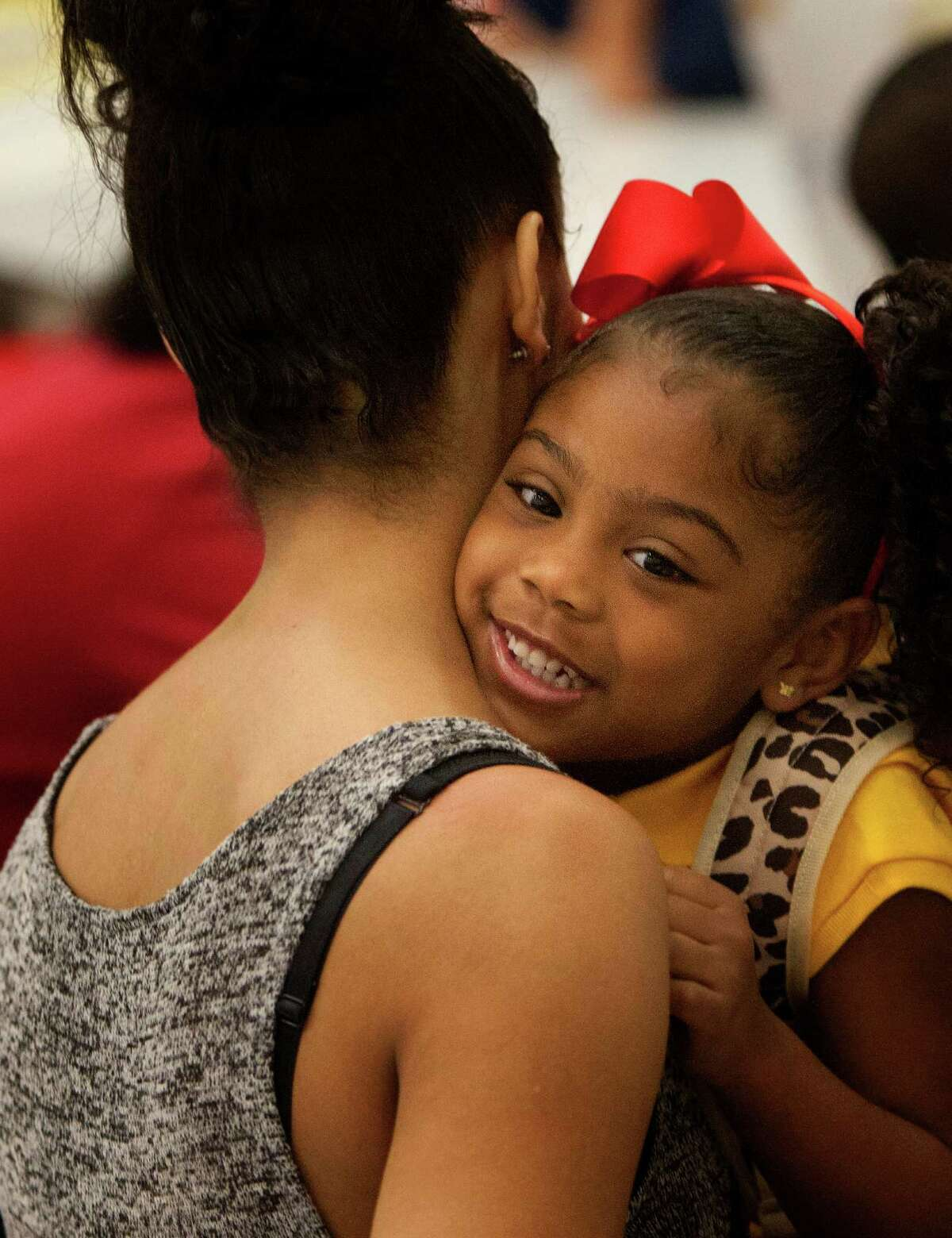 Josie Roberts hugs her daughter, Kyndall, 5, during her first day at the former North Forest school.