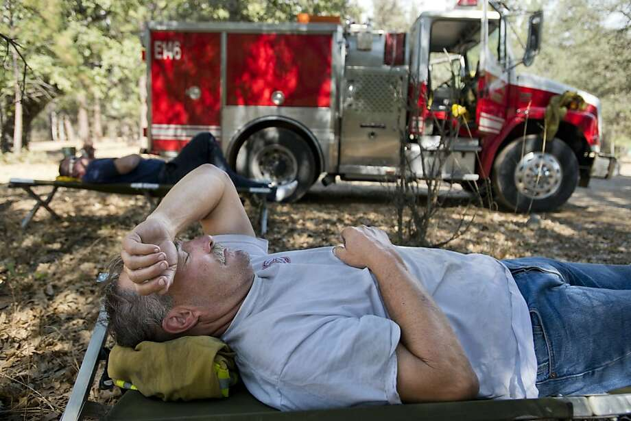 Sacramento River Fire District Captain Jerry Winters, 61, rest at  base camp before the start of the night shift with Engineer Scott Stanfield fighting the Rim Fire in the Stanislaus National Forest  along Highway 120 near Yosemite National Park, Monday, Aug. 26, 2013 in, Calif. With winds gusting to 25mph on Sierra, hundreds of firefighters have been deployed to protect this and other communities in the path of the Rim Fire raging north of Yosemite National Park. (AP Photo/The Sacramento Bee, Paul Kitagaki Jr.) Photo: Paul Kitagaki Jr., Associated Press