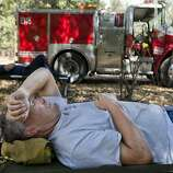 Sacramento River Fire District Capt. Jerry Winters rests at base camp before the night shift fighting the Rim Fire in the Stanislaus National Forest. The blaze, which erupted Aug. 17 on the western edge of Yosemite, has grown to more than 250 square miles and destroyed 23 structures.