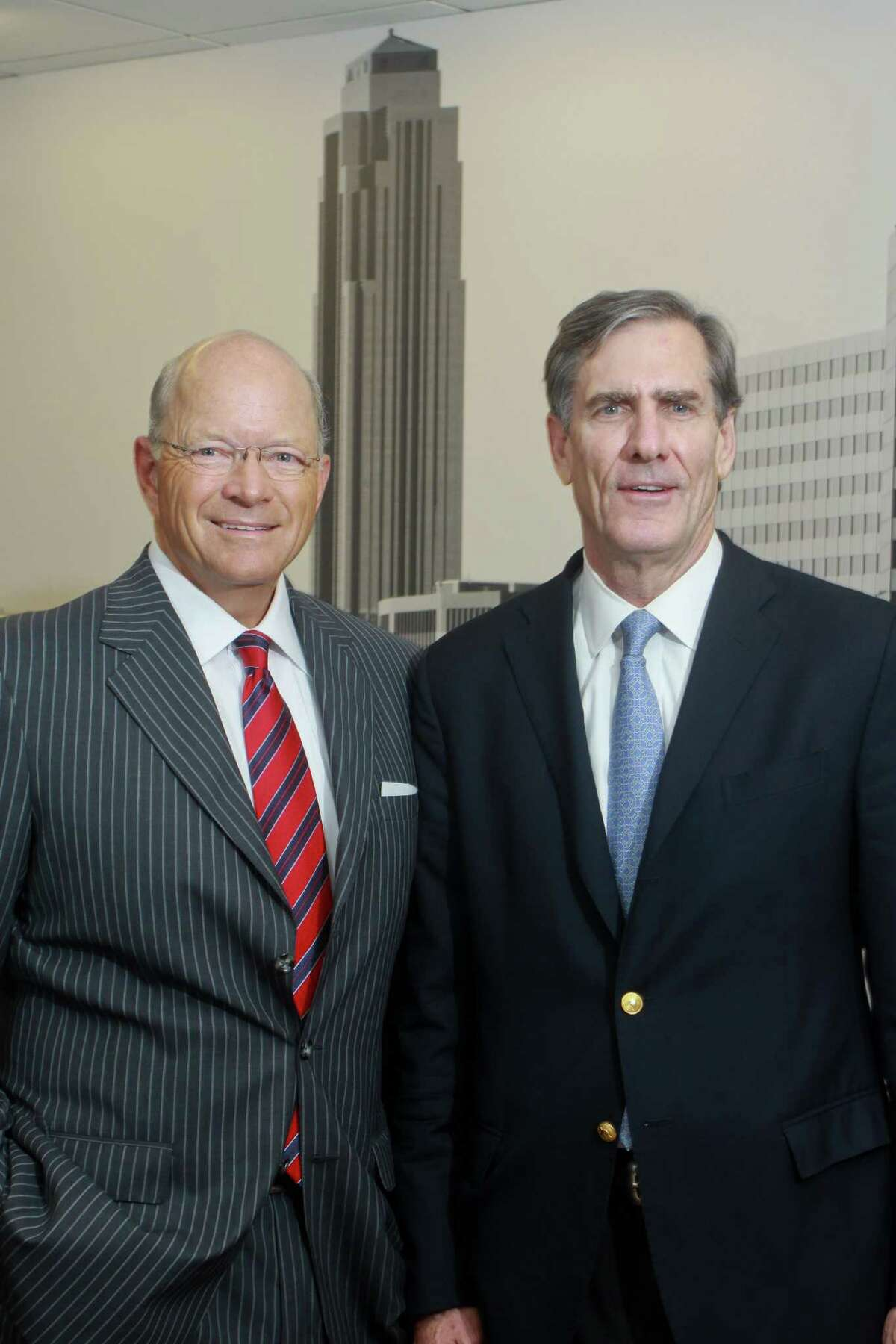 (For the Chronicle/Gary Fountain, August 26, 2013) Dan Bellow, president of Jones Lang LaSalle in Houston, left, and Doug Knaus, in front of a mural of the Houston skyline in the Jones Lang LaSalle office.Jones Lang LaSalle announced today that it has acquired Means Knaus Partners, a Houston-based property management company founded in 1998 by Steve Means and Doug Knaus.