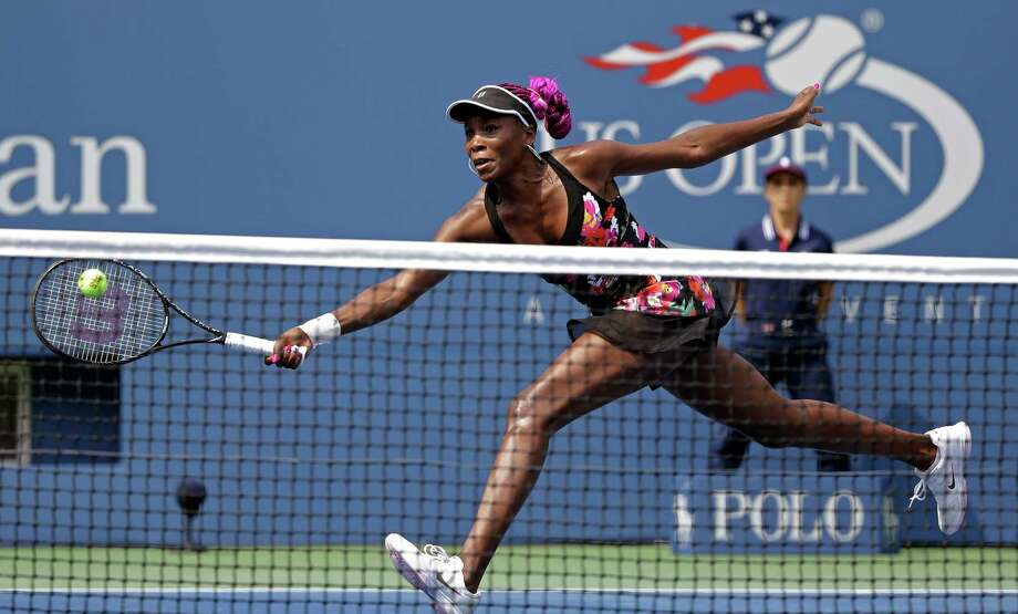 Venus Williams returns a shot to Belgium's Kirsten Flipkens during the first round of the 2013 U.S. Open tennis tournament, Monday, Aug. 26, 2013, in New York. Williams defeated Flipkens. (AP Photo/David Goldman) ORG XMIT: USO164 Photo: David Goldman / AP