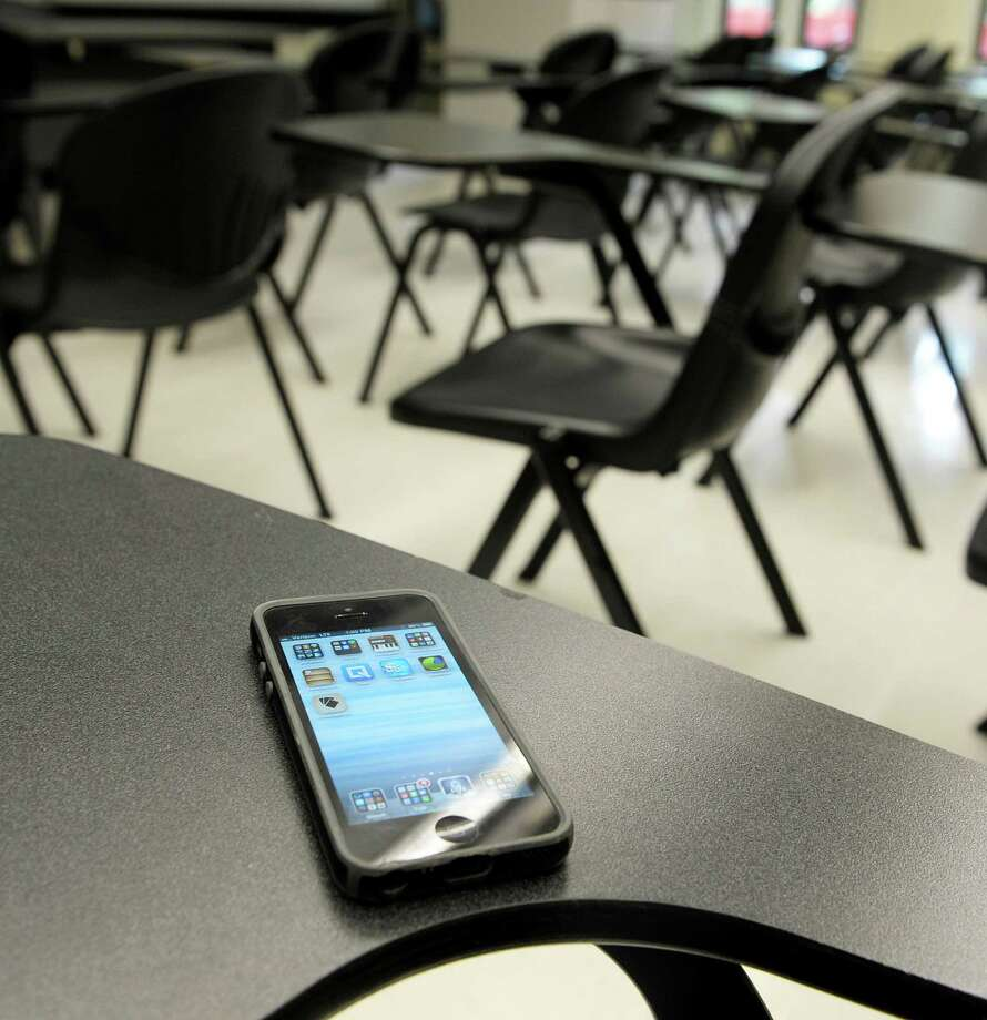 Photo Illustration - A smart phone on a desk in a classroom at the UAlbany campus on Monday, Aug. 26, 2013 in Albany, NY.   (Paul Buckowski / Times Union) Photo: Paul Buckowski / 00023644A