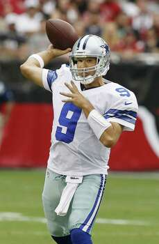 Tony Romo threw 19 interceptions last season in part because he tossed 40.5 passes a game. Photo: Ross D. Franklin / Associated Press