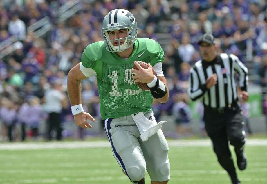 Jake Waters, Kansas State's starting quarterback, led Iowa Western to the junior college national title last season. Photo: Peter G. Aiken / Getty Images