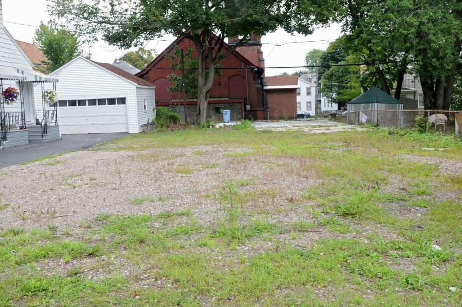 Empty lot at 581 Sixth Avenue on Monday, Aug. 26, 2013 in Watervliet, N.Y. A Watervliet couple, Kristopher and Sarah Brenenstuhl, are suing their insurance company for refusing to cover the costs of a fire, that happened in 2010, the insurance company considers arson even though no arson charge was filed. (Lori Van Buren / Times Union) Photo: Lori Van Buren / 00023645A