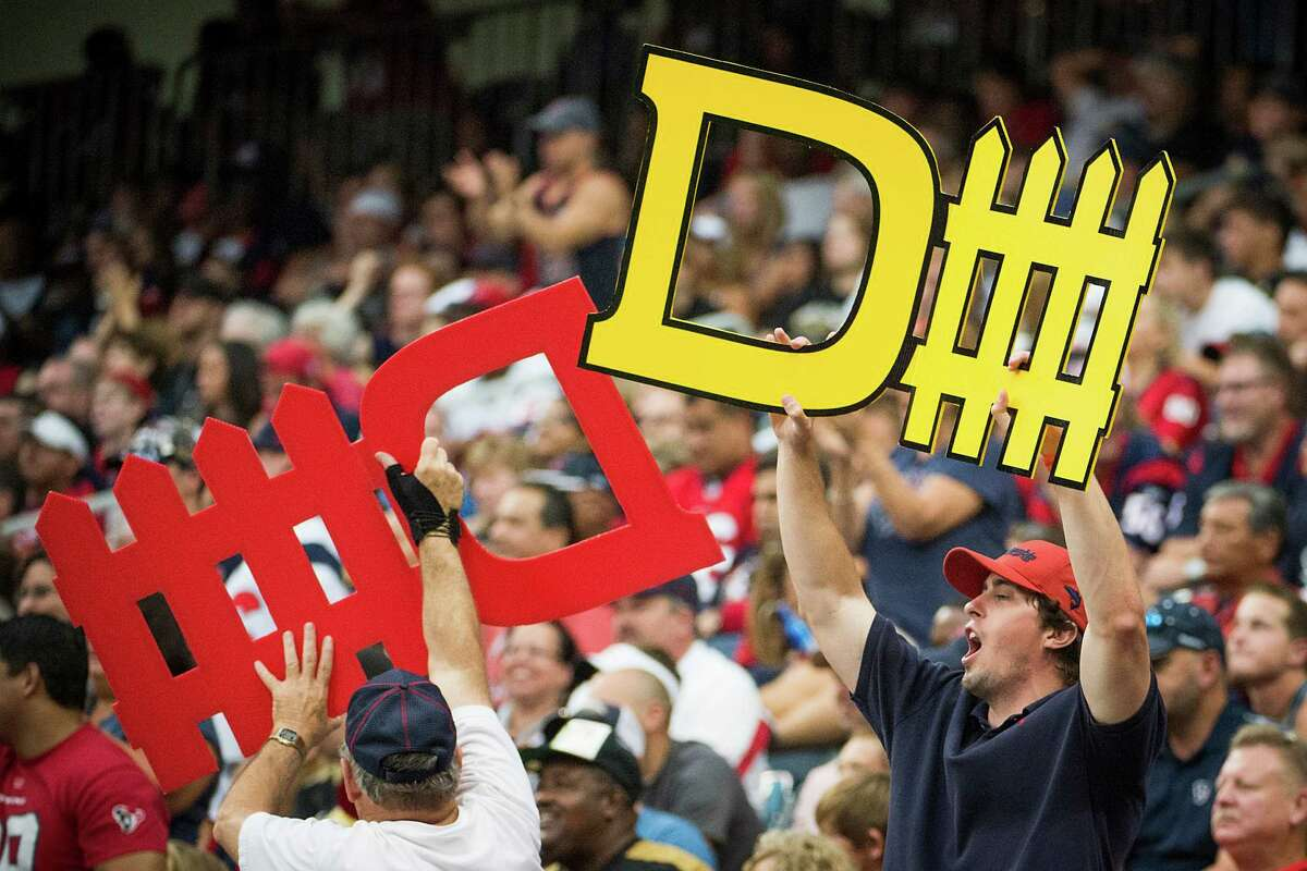 Houston Texans fans cheer on their defense during the second half of a preseason NFL football game against the New Orleans Saints at Reliant Stadium on Sunday, Aug. 25, 2013, in Houston. ( Smiley N. Pool / Houston Chronicle )